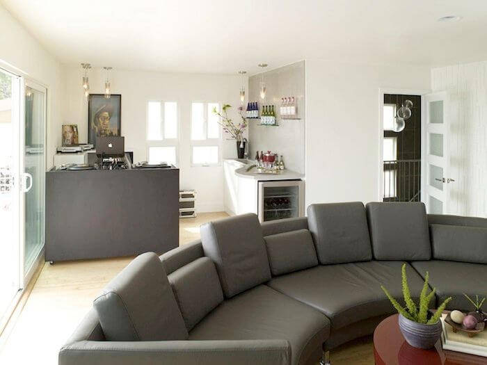 On The Top Floor Is The Family Room, Which Has A Modern Circular Sectional  Sofa