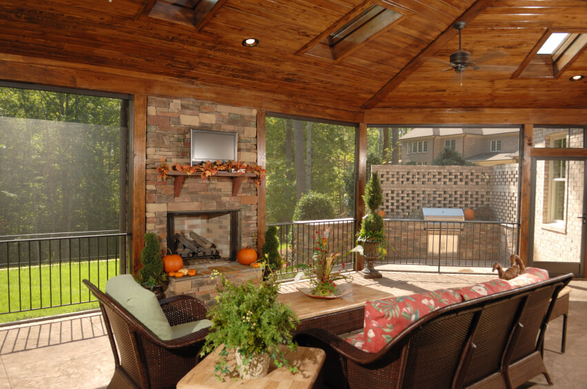 this screened in patio has an enormous arched wooden ceiling with ample skylights a screen - Enclosed Outdoor Patio Ideas