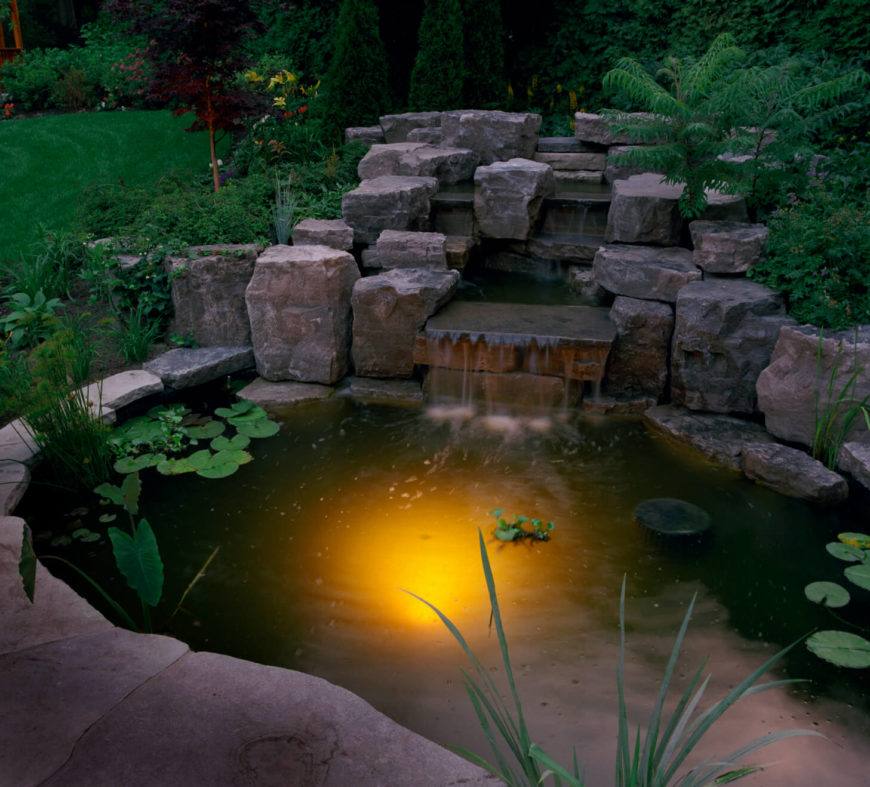Waterfalls For Backyard: At Nighttime, This Pond With A Small Waterfall Lights Up