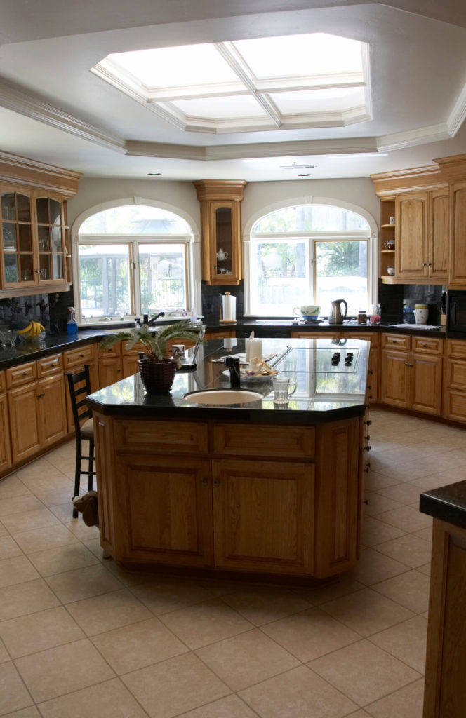 This kitchen has an interesting skylight. The skylight is shaped almost  like a window,