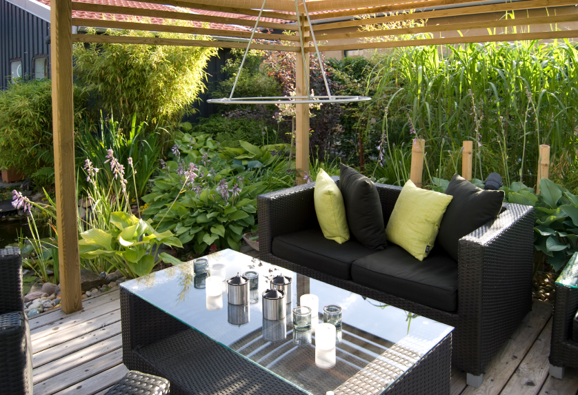This Small, Yet Elegant Covered Wood Patio Boasts A Glass Topped Black  Wicker Coffee