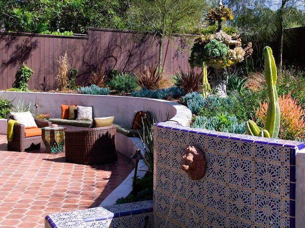 Nearby is another seating area and a lion's head fountain in a beautiful mosaic tile.
