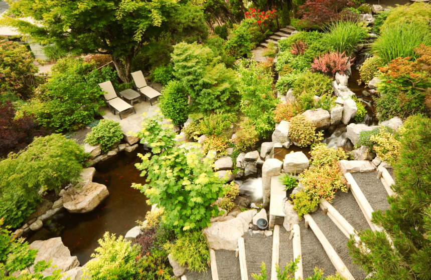 a birds eye view of stone steps leading down past a stream with multiple waterfalls that - Garden Design Birds Eye View