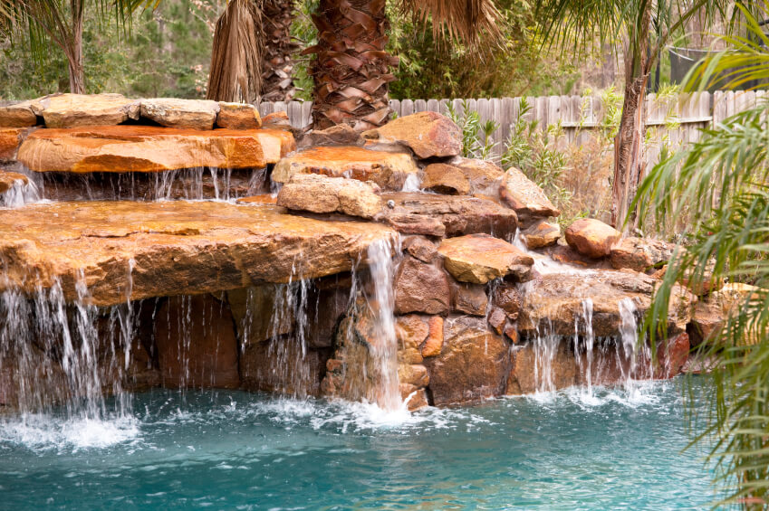 inground pools with rock waterfalls. A Natural Stone Stacked Waterfall With Water Running Off Nearly Every Surface And Into The Pool Inground Pools Rock Waterfalls |