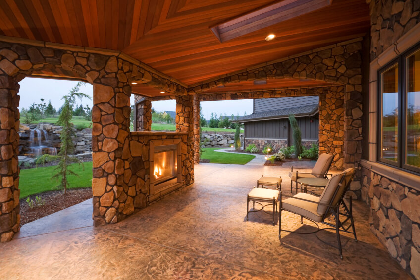 The Cedar Ceiling Of This Stone Encased Patio Provides A Stunning, Rich  Tone To