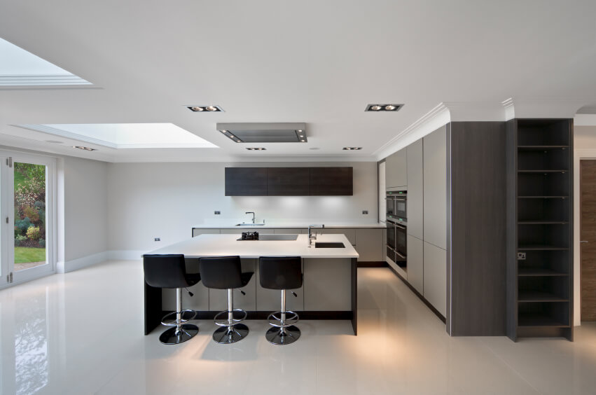 Modern colors, and a contemporary polished look bring this kitchen  together. A skylight creates