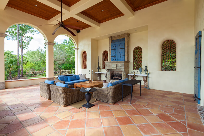 An Enormous Stone Tile Patio In A Spanish Design, Featuring Latticed  Windows And An Enormous