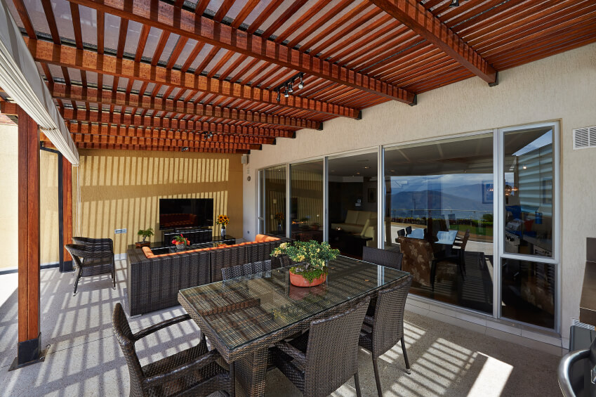 As light shines down on this pergola, it creates an eye-popping shadow  pattern