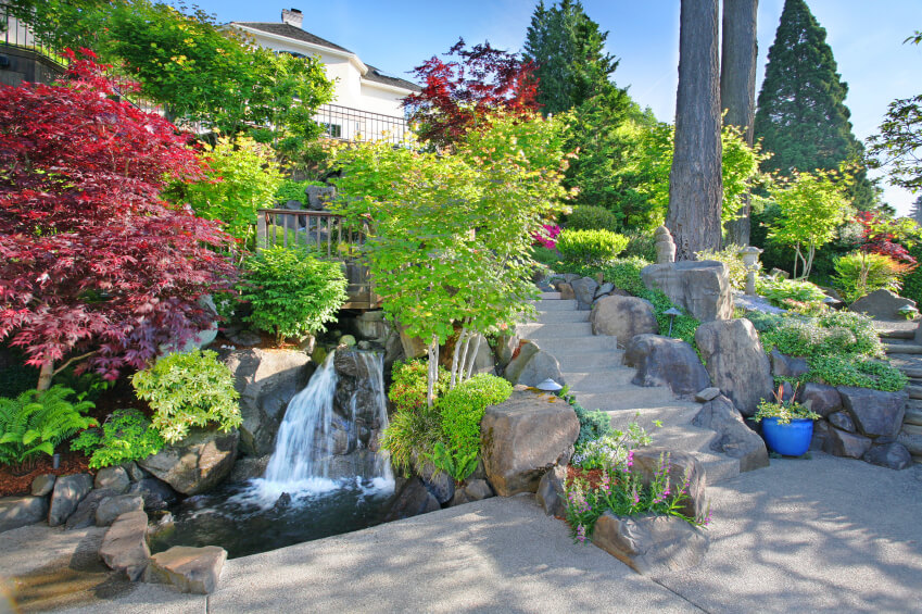 A Winding Stream Follows The Long Stone Stairway Down To This Patio. The  Stream Ends