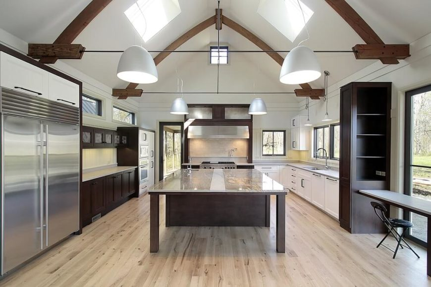 Here we have a thoroughly modern kitchen fitted with a vaulted ceiling and  exposed dark wood