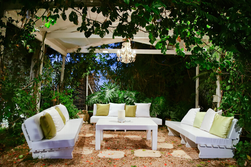 This Gorgeous, Serene Garden Patio Rests Beneath An Iron Structure. Simple  White Benches Are