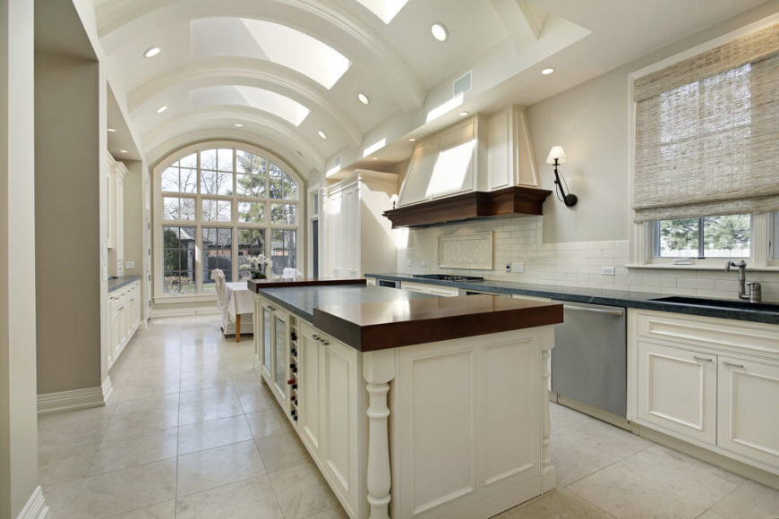 This Grand, Arched Ceiling Kitchen Features A Multitude Of Skylights,  Naturally Illuminating The Entire