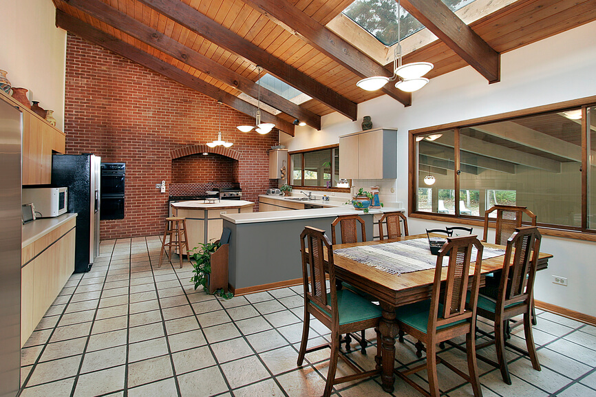 This Kitchen Combines Traditional Brick Work And Natural Light Hardwood.  Skylights Move Across The Ceiling
