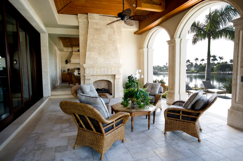 A Beautiful Stone Patio With A Fireplace.