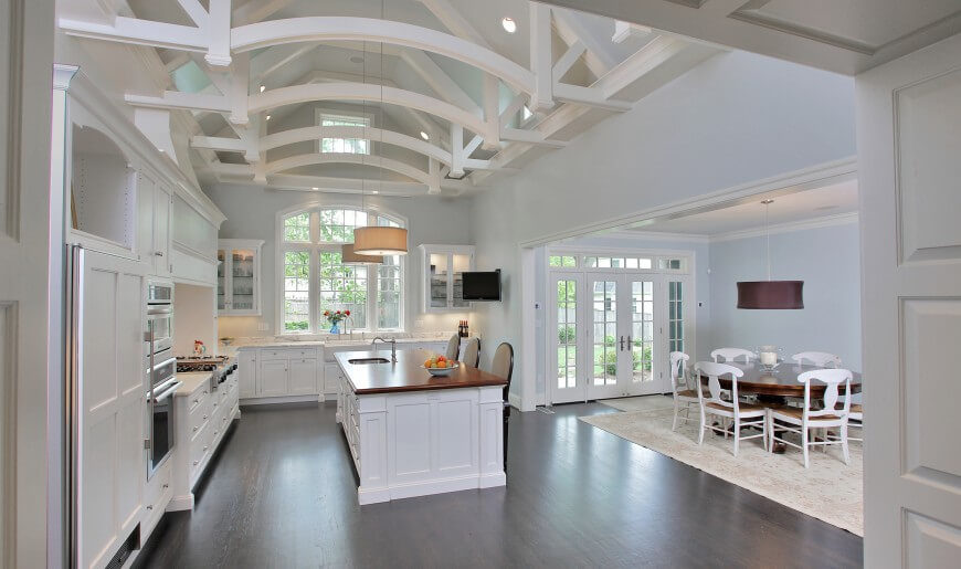 43 stunning kitchen designs by top interior designers for Vaulted ceiling kitchen designs