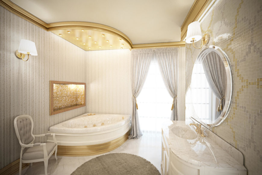 The bathroom houses a large corner soaking tub in marble, framed in gold. Floor to ceiling windows appear in this space as well.