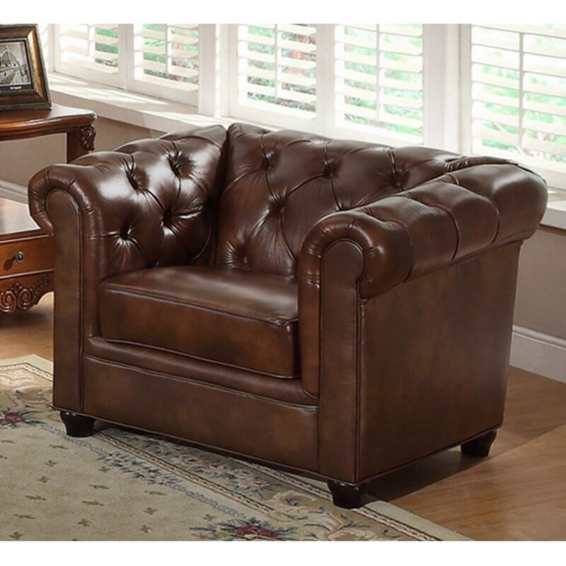 This Elegant Leather Club Chair Features Voluptuous Button Tufted  Cushioning, Wrapping Around Roll Arms