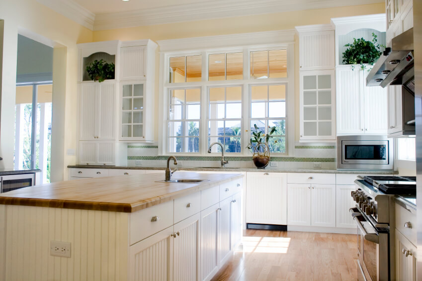 this traditionally styled kitchen centers on a massive island filled
