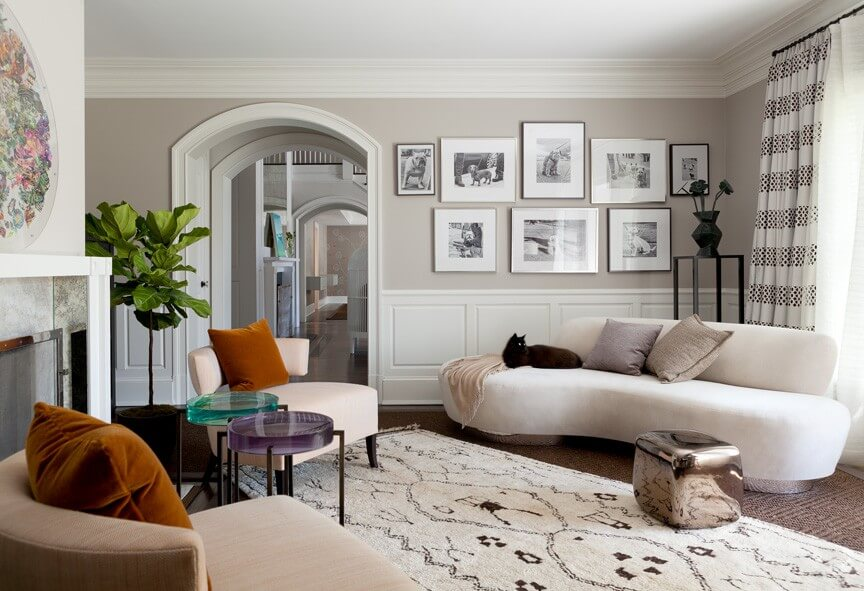 A Beautiful Contemporary Living Room Featuring Two Small End Tables Each With Different Colored