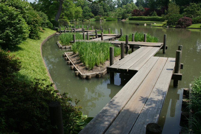 this zig zagging garden bridge design carries visitors over a lengthy pond and across several - Japanese Garden Bridge Design