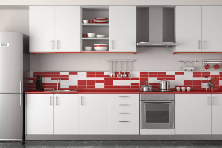 Our final kitchen boats a mostly subtle arrangement of bright red and white design, confined to a slim but attractive tile brick backsplash. The Tetris-like design ties the white cabinetry and red trim together.