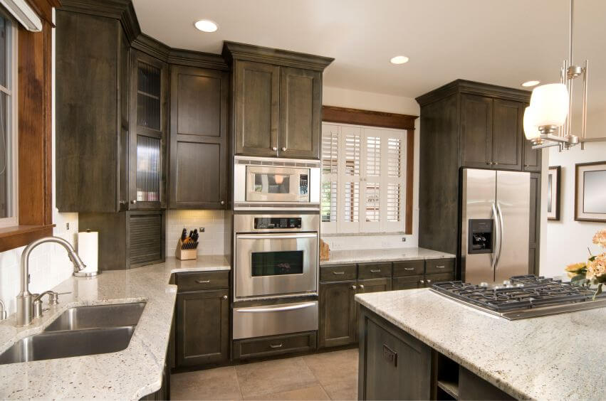 Traditional Kitchen With Mocha Cabinets And Light Quartz Countertops