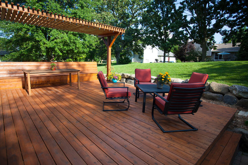 This Bespoke Hardwood Deck Stands Next To A Lawn Framed In Large