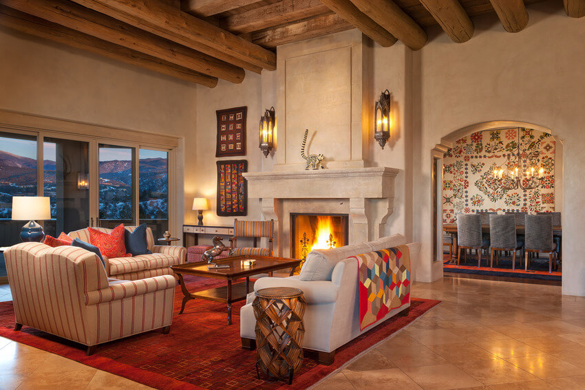 A Cavernous Living Room With Exposed Wooden Beams Across The Ceiling And A  Number Of Bold