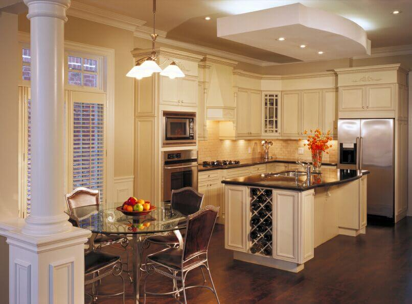 Dark wood and light granite with beige walls large seamless windows - 37 Fantastic L Shaped Kitchen Designs