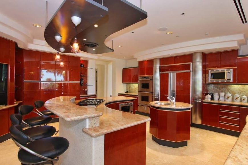 Luxurious red kitchen with U-shaped island and round island.