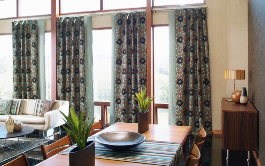 In This Case, The Bold Floral Pattern Of These Turquoise And Brown Curtains  Pulls Color