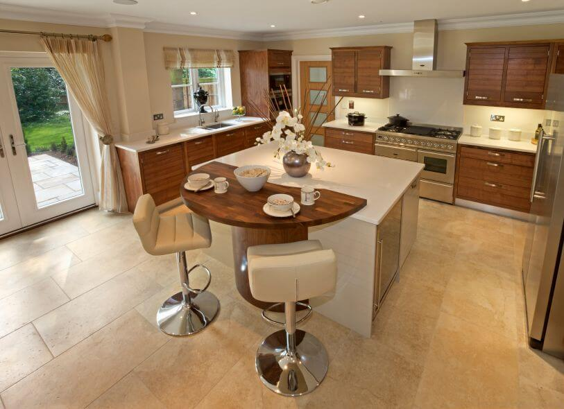 spacious kitchen with beige tile flooring and a square white kitchen ...