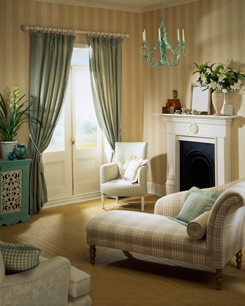 This Living Room Has A More Toned Down Design, With Soft Plaids And Dusky  Blues