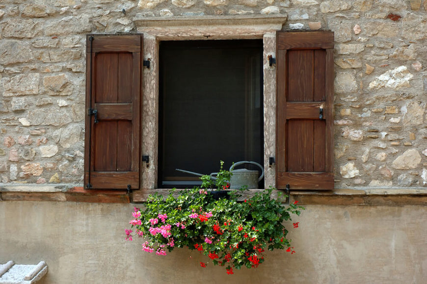 Window box with wooden shutters.