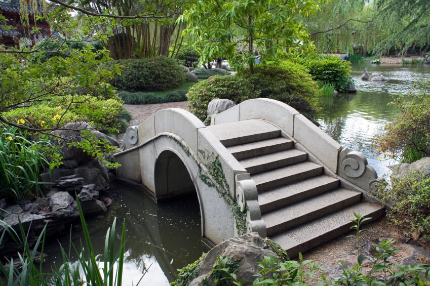 The Ornate Swirls Of Stone Along This Arched Stone Bridge Adds A Whimsical  Element To This