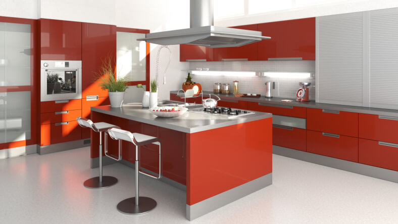 In this mock-up for another red kitchen, we can appreciate the clean lines and bold framing, courtesy of neutral white and grey tones surrounding wide splashes of red on the cabinetry. The large island features built-in sink and cooktop, as well as dining space for two.