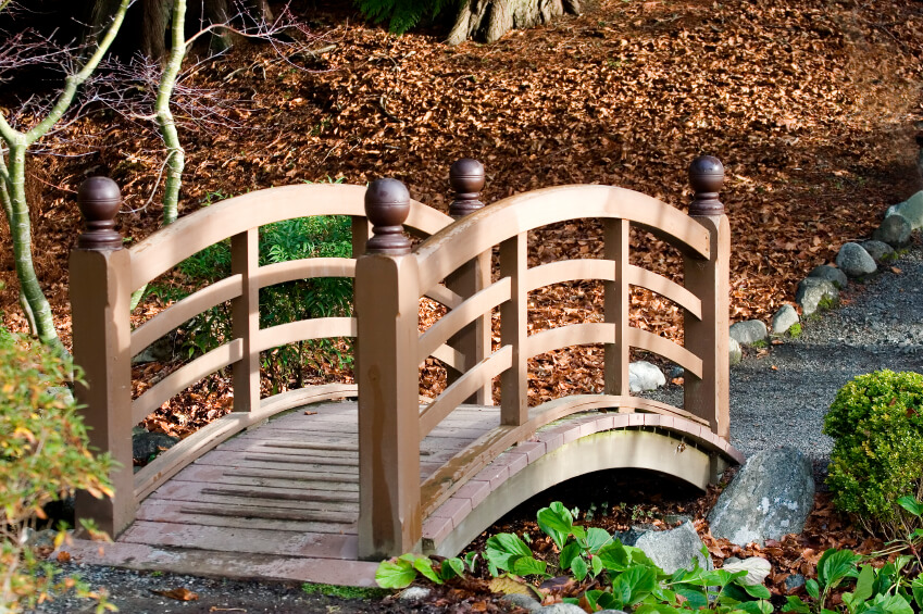 This Is An Example Of A Small Garden Bridge In Wood. Rather Than Bridging  The