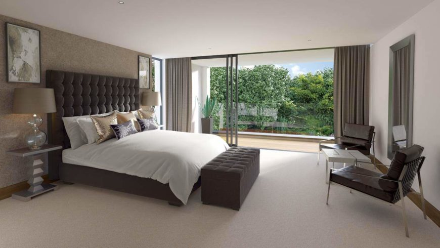 The master bedroom is on the highest level of the home, and has sliding glass doors that lead out on to the balcony, which, keeping in common with the rest of the home, has glass balustrades. The stately upholstered bed frame is button-tufted and rises nearly three-quarters up the wall. The storage bench at the foot of the bed matches the headboard perfectly.