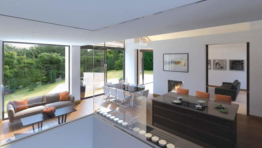 A view of the small seating area, dining room, and kitchen from the glass-enclosed staircase. From this angle, we can also see the lushly landscaped backyard, which can be accessed from sliding glass doors near the dining room. All the glass in this home allows natural light to sweep throughout the rooms.