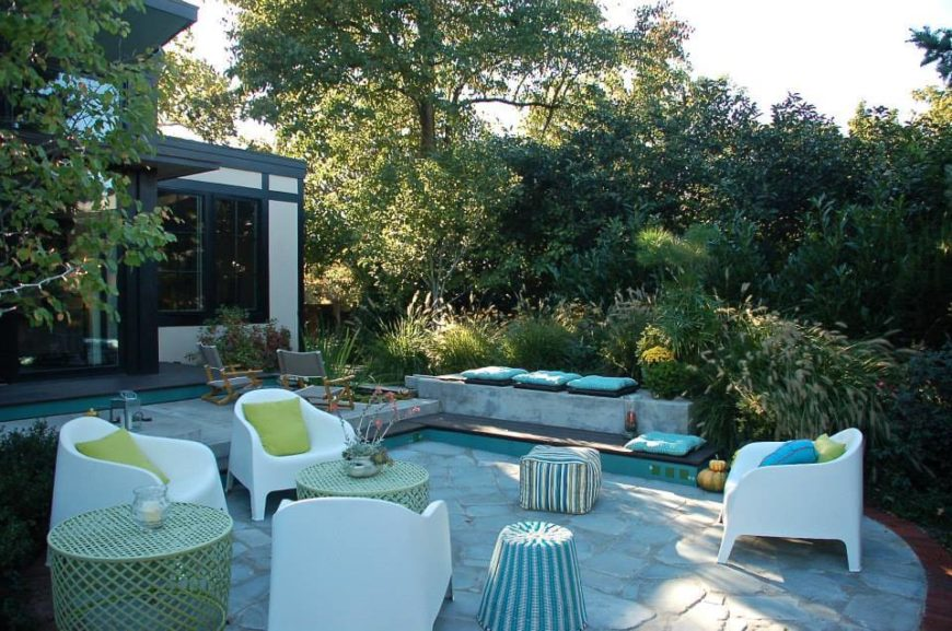The Back Patio Shares A Host Of Unique Seating Options, With White  Armchairs And Wicker