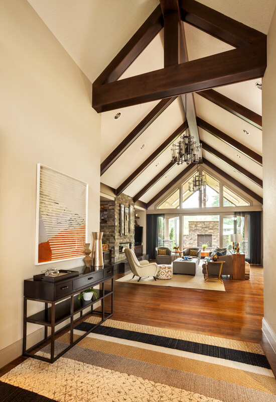 A look into the living room from the entryway, showing the exposed wood  beams and  Modern French contemporary parisian Interiors ...