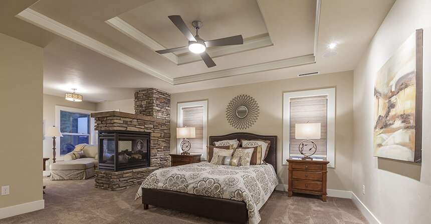 This Bedroom Is Separated Into Two Distinct Areas By The Stone Fireplace.  The Screened