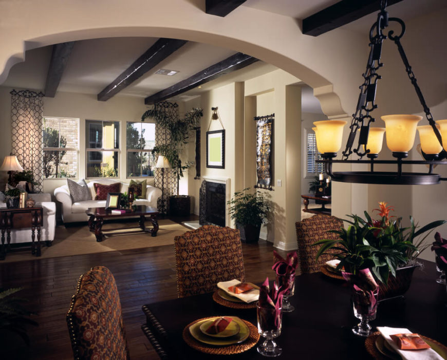 An Ornate Southwestern Style Archway Leads From The Dining Room Into Living