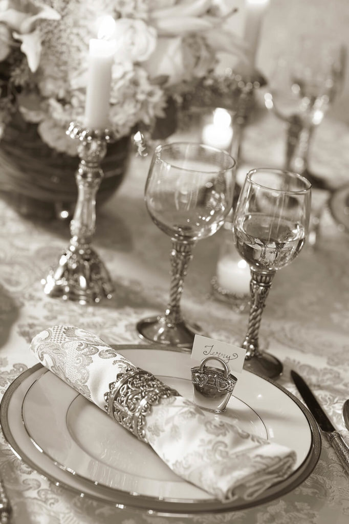 beautiful wedding table setting in silver and white with ornate wine ...