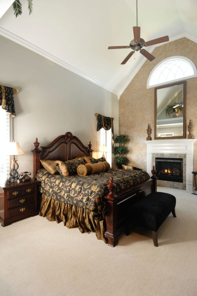 A More Traditional Bedroom In Beige With Contrasting Dark Wood Furniture  And Rich Texture In The