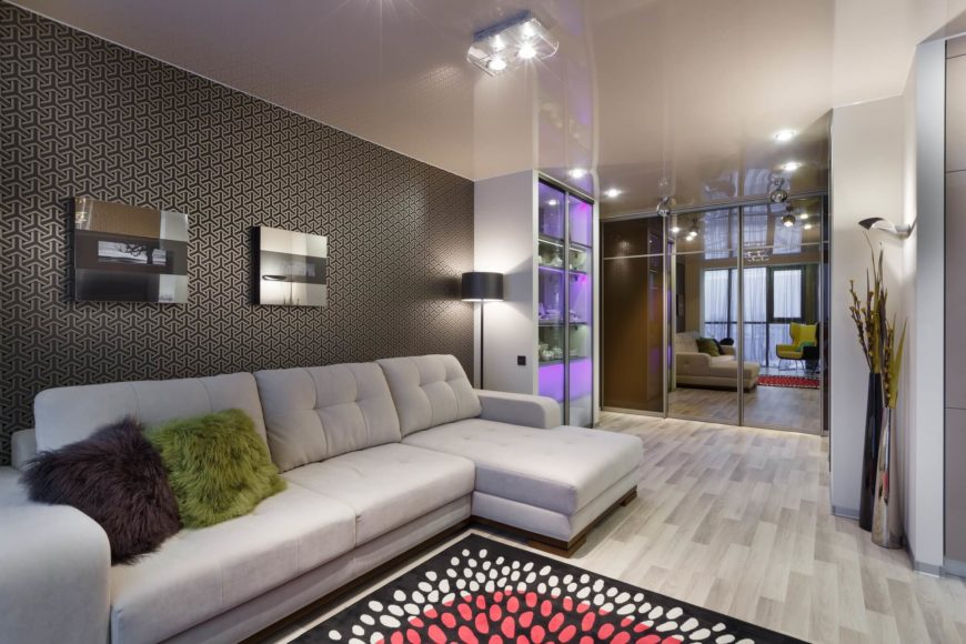 From the other side of the living room, the lights on the display case seem less jolting, and we are able to appreciate the eye-popping wallpaper behind the sofa. The area rug is in a different pattern, creating a layered effect.