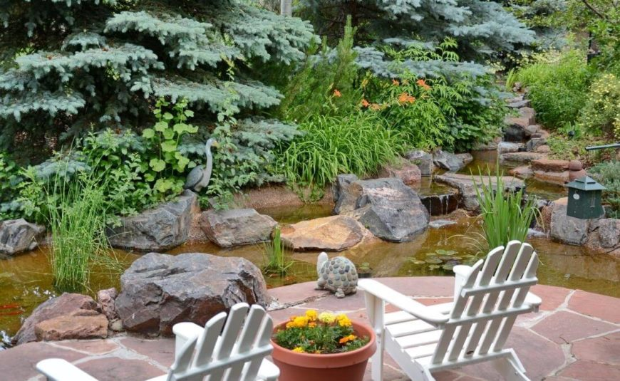 Here we have a close view of the patio edge, with surrounding water feature. Careful placement of large stones makes for an ideal garden pond.