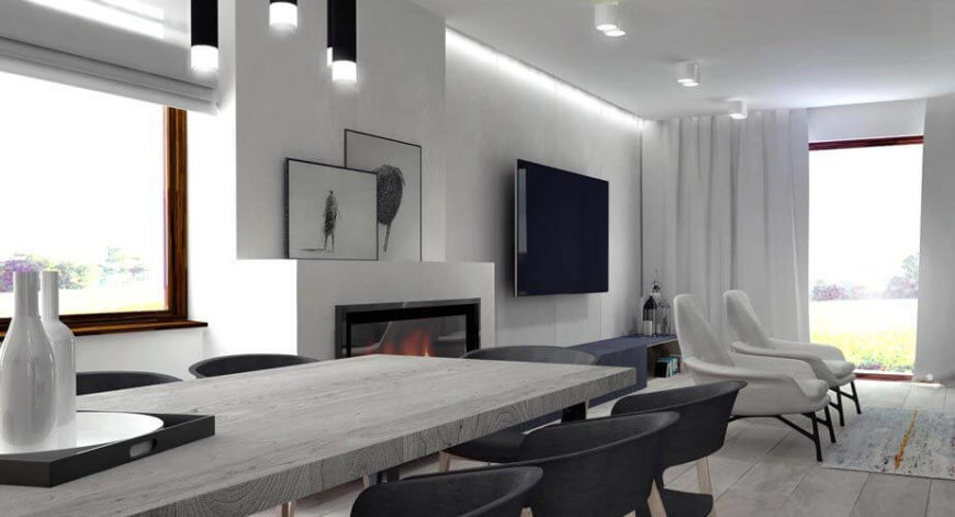 The Dining Room Features A Large All Wood Table In Gray And Low