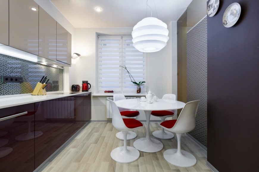 Modern kitchen and dining room with hardwood floors.