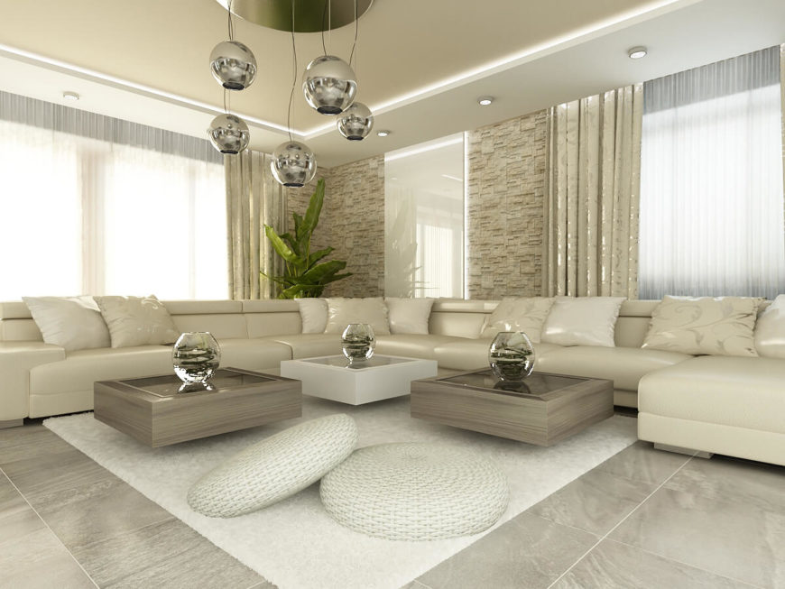 The living room features this gorgeous wrap-around couch in cream leather, gray marble floors and a beautiful stone facade on the walls. The metallic touches found in the lights and curtains add extra class while the low setting of the couch is mimicked in the coffee tables. The use of bold textures, found in the plush carpet and round floor pillows, offset the sleek feeling of the rest of the room.